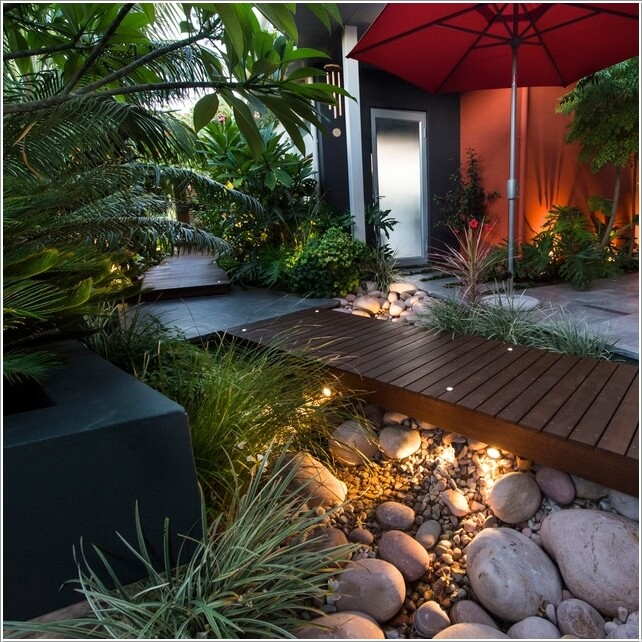 Wedo thiết kế tiểu cảnh sân vườn đẹp và độc đáo với ghế gỗ, đá sỏi và cây xanh