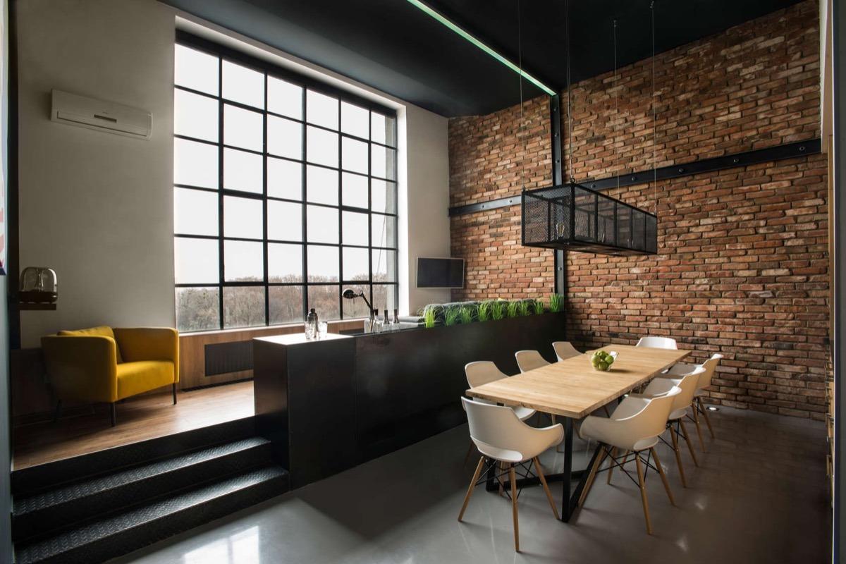 thiết kế thi công nội thất phòng sinh hoạt chung đẹp với chủ đề gạch trần.