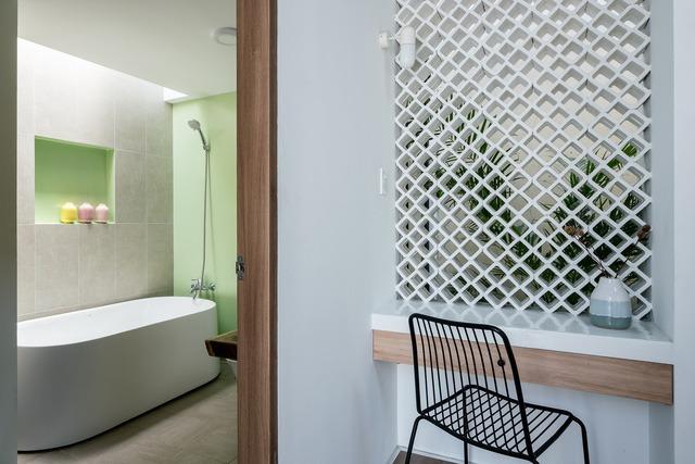 [Ảnh] Thiết kế đặc biệt giúp ngôi nhà ở TP HCM chống lại nắng nóng - Ảnh 14.
